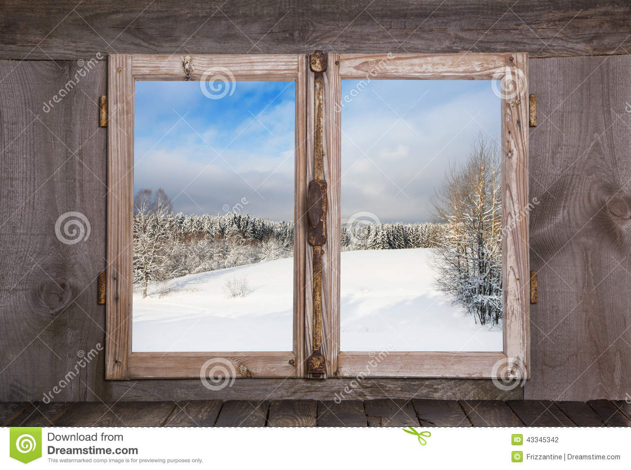 Snowy winter landscape. View out of an old rustic wooden window.