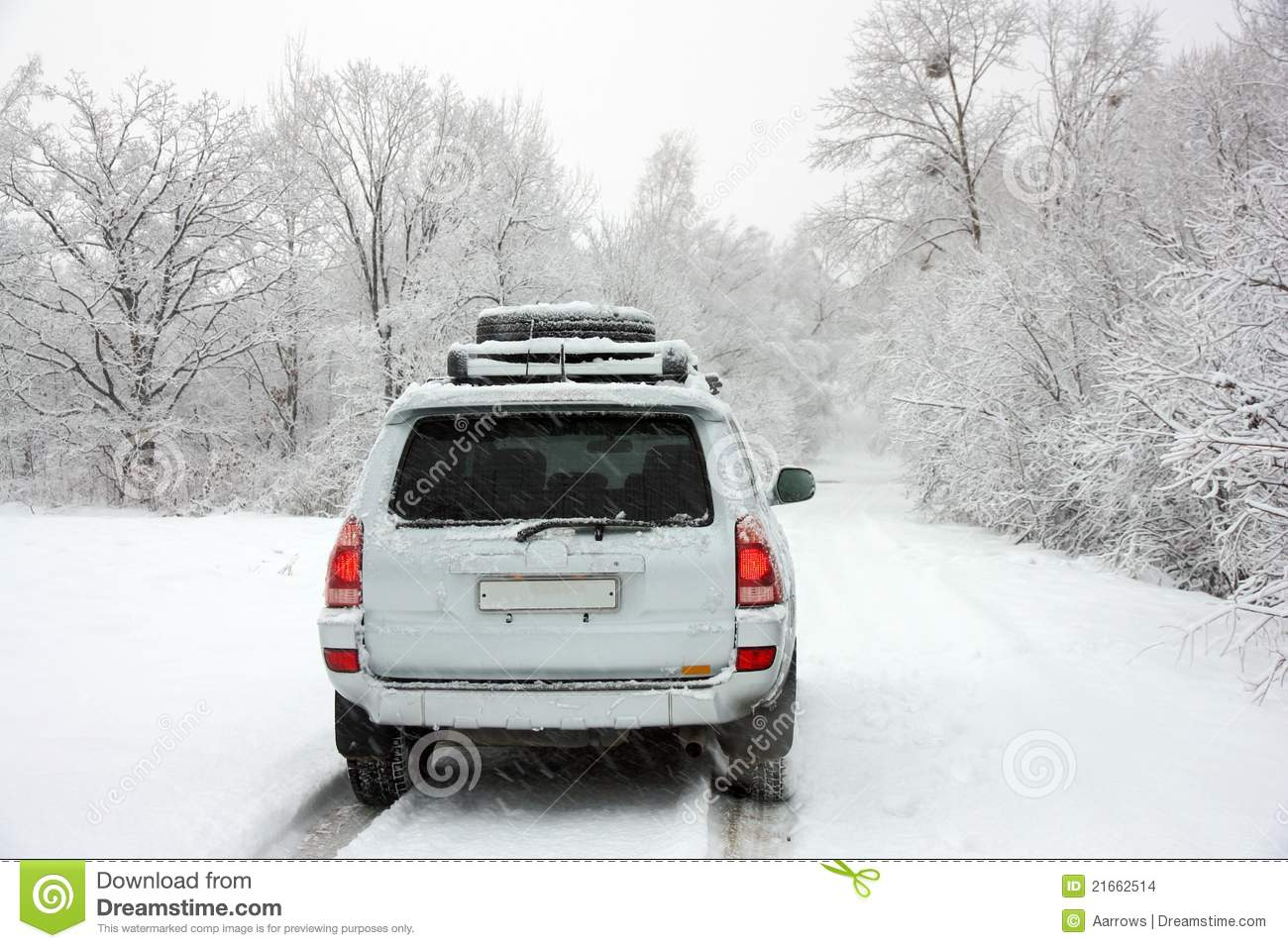 Snowy winter road behind an unrecognizable car