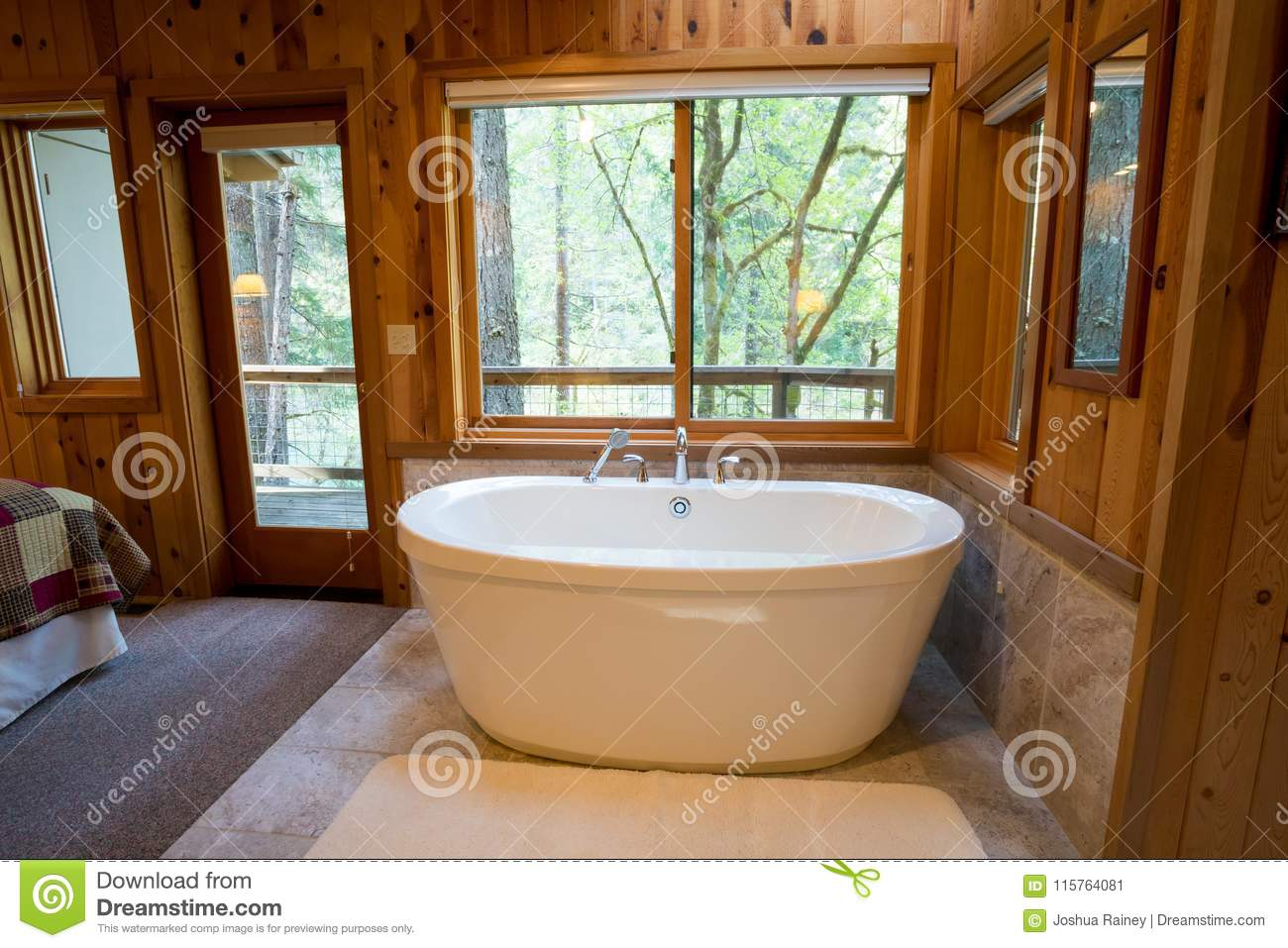 Soaking Bath Tub in Cabin stock image. Image of expensive - 115764081