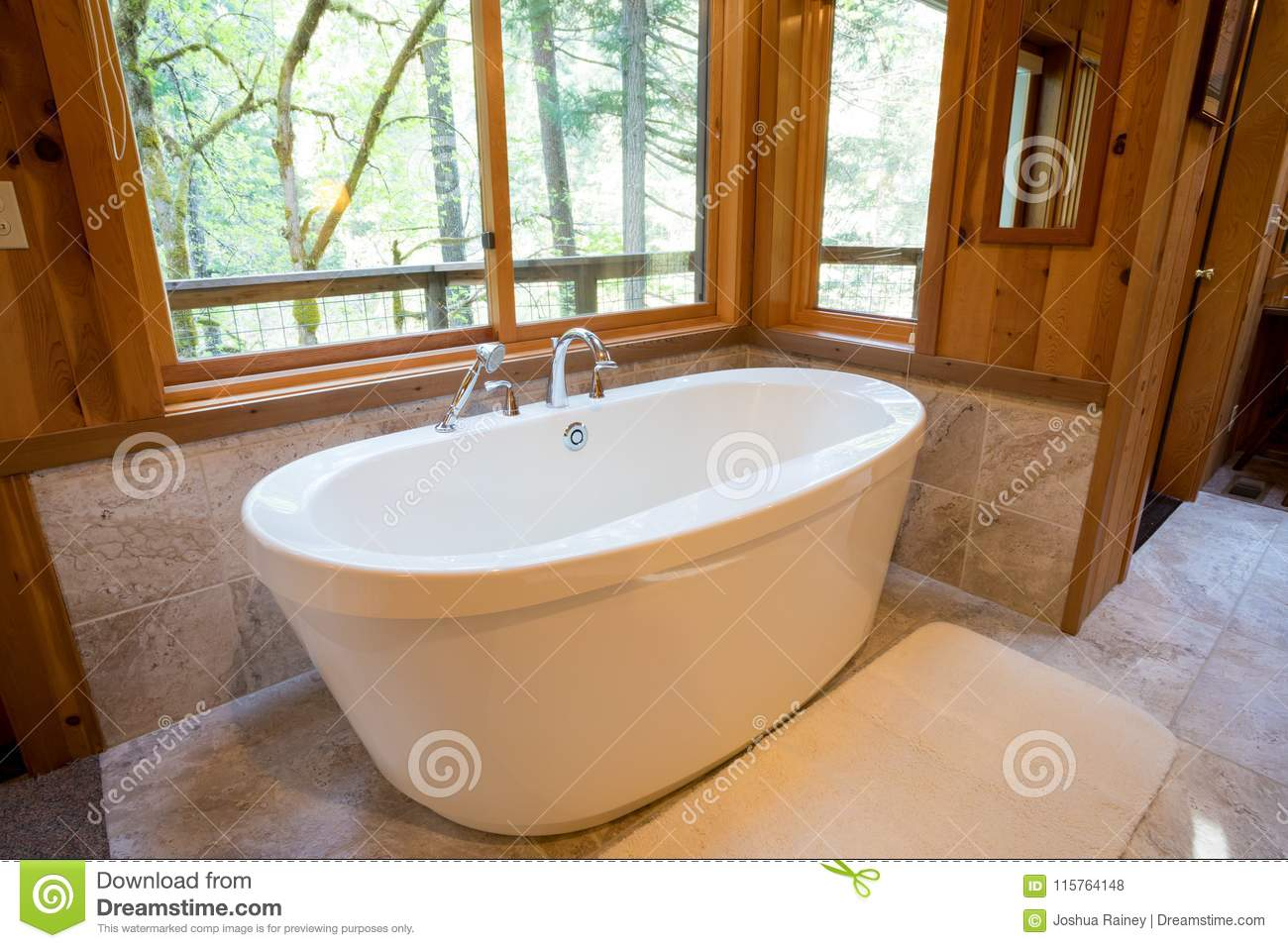 Soaking Bath Tub in Cabin stock photo. Image of bathtubs - 115764148