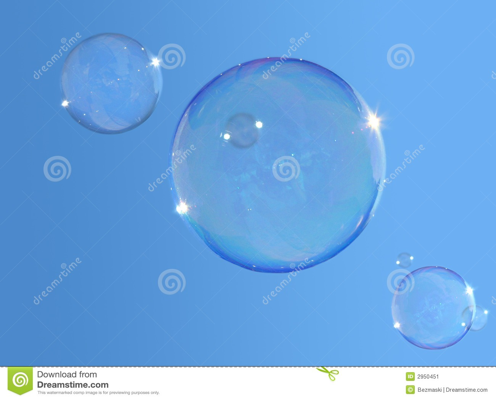 Soap-bubbles on blue sky
