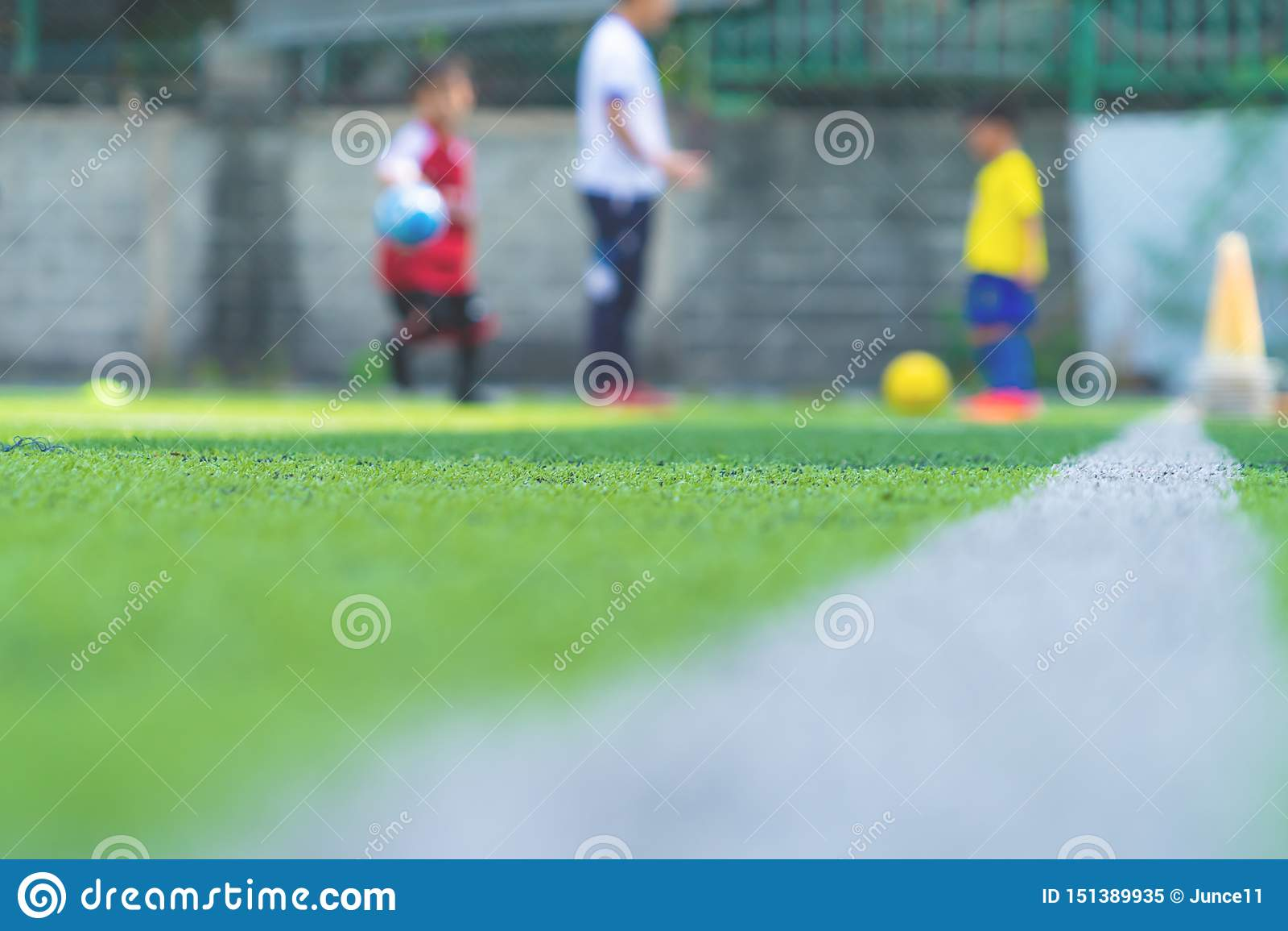 Soccer Academy for children training blurred for background