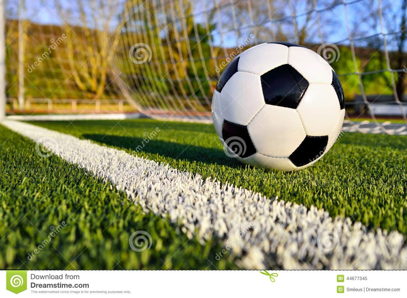 soccer ball behind the goal line stock photo
