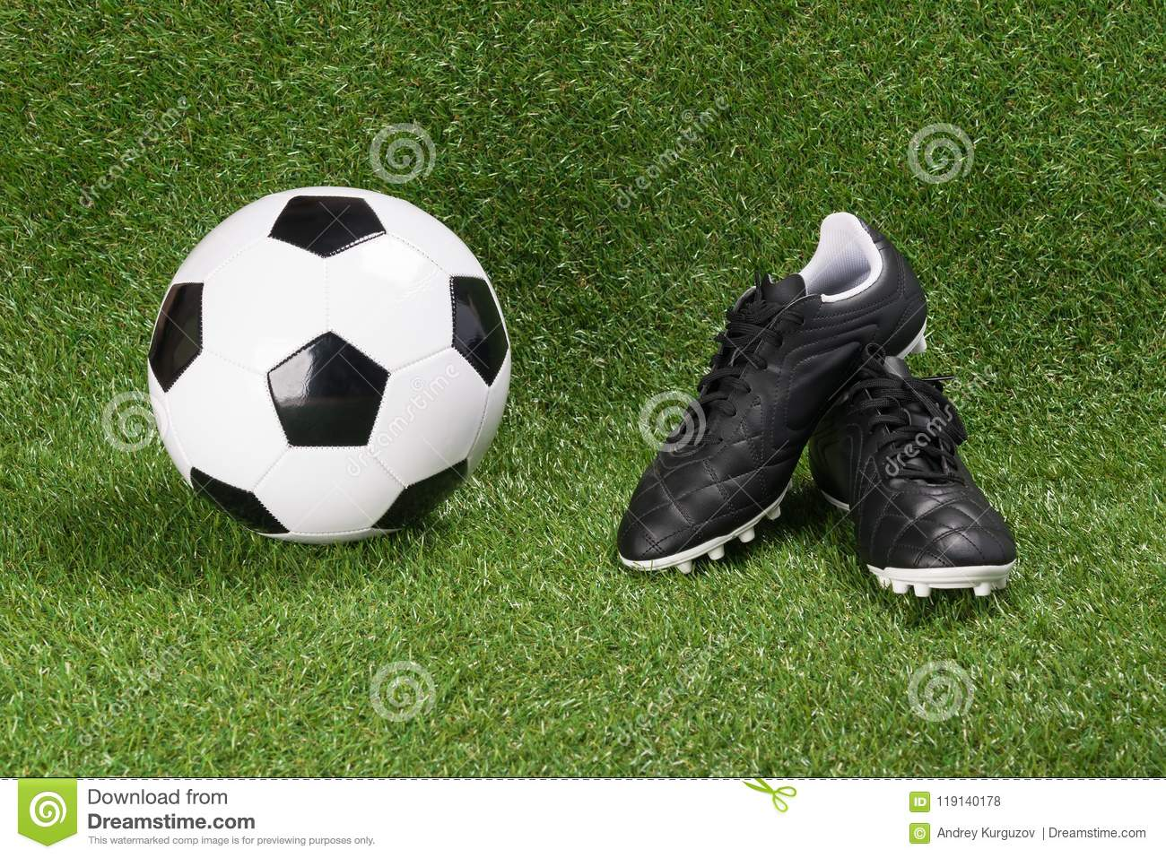26e891dc2bc Soccer Ball And Boots On A Green Artificial Turf Stock Photo - Image ...