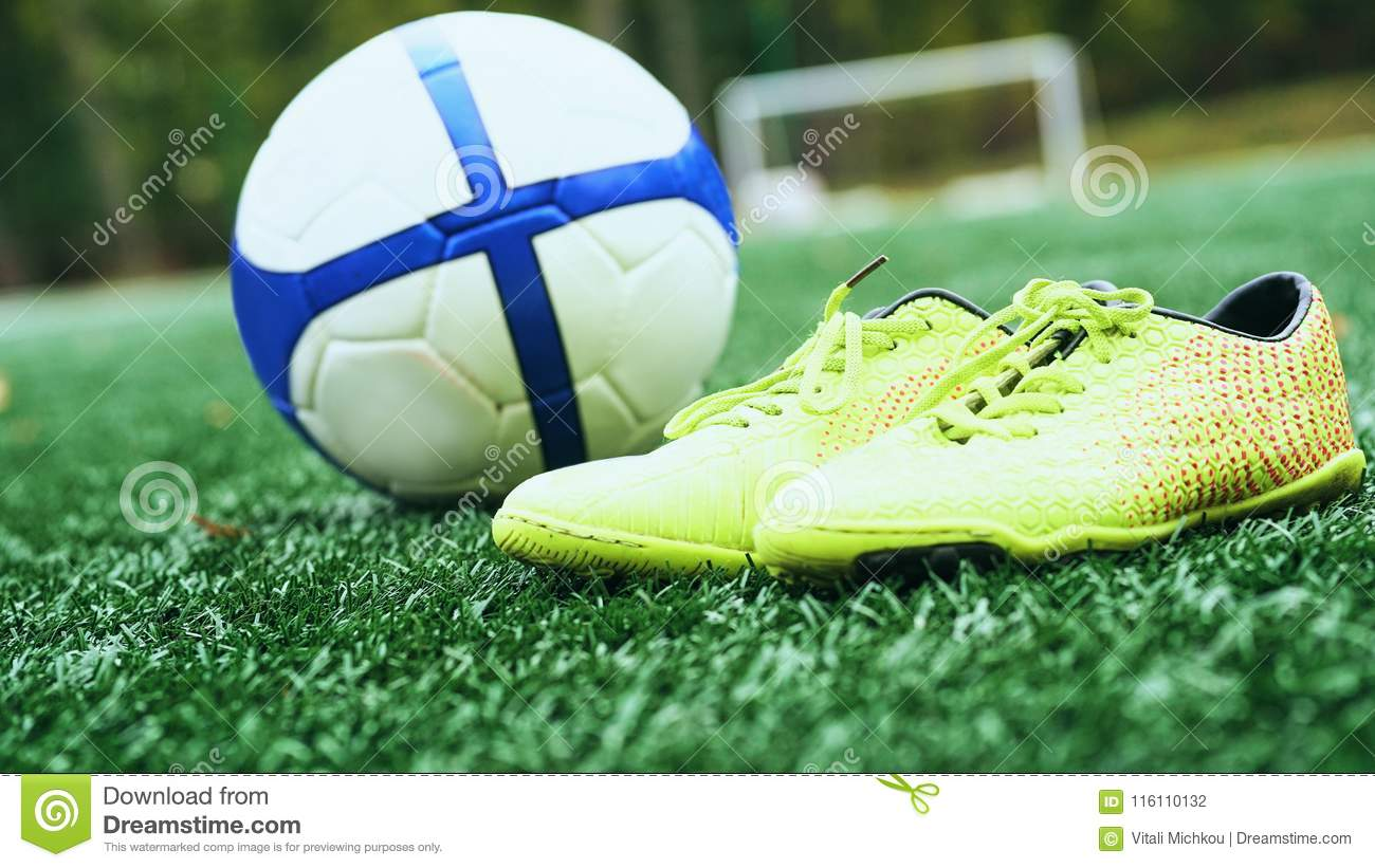 a8efa0ef232 Soccer Ball And Football Boots On Green Grass Stock Photo - Image of ...