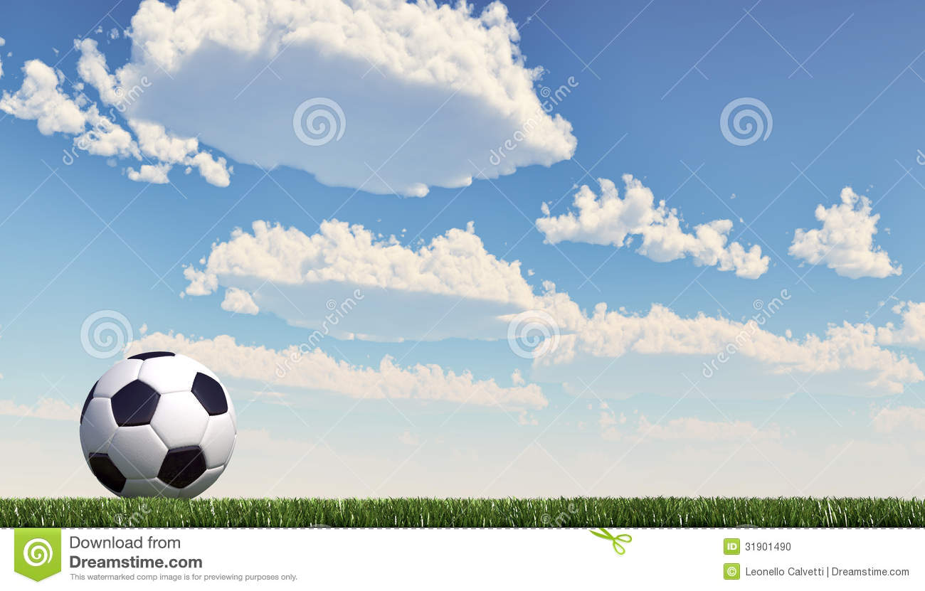 Soccer ball/football close-up on grass lawn. Panoramic format.
