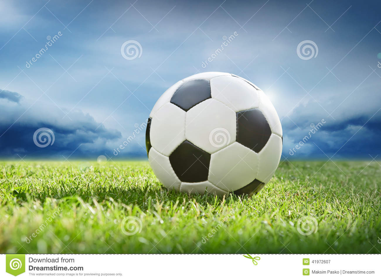 Soccer Football On Green Field With Blue Sky Background: Soccer Ball On Green Grass Stock Photo