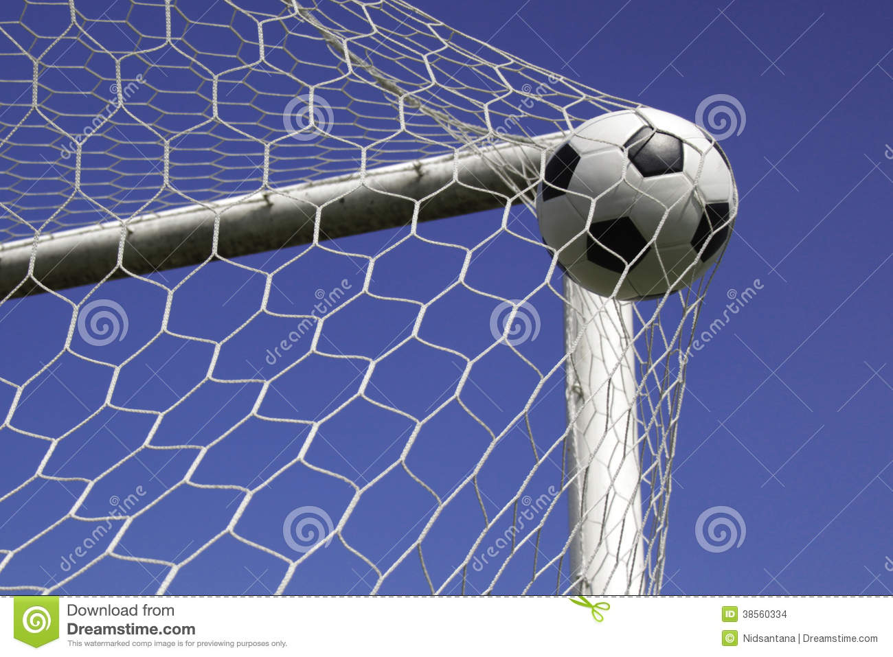 Soccer Football On Green Field With Blue Sky Background: Soccer Ball In Net Goal. Stock Images