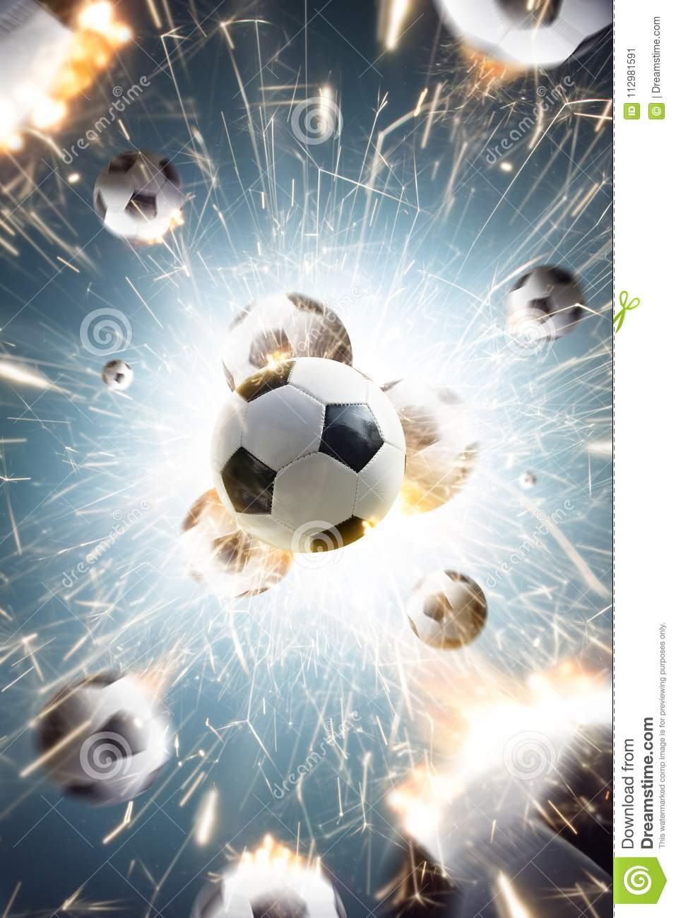 Soccer balls with fire sparks in action