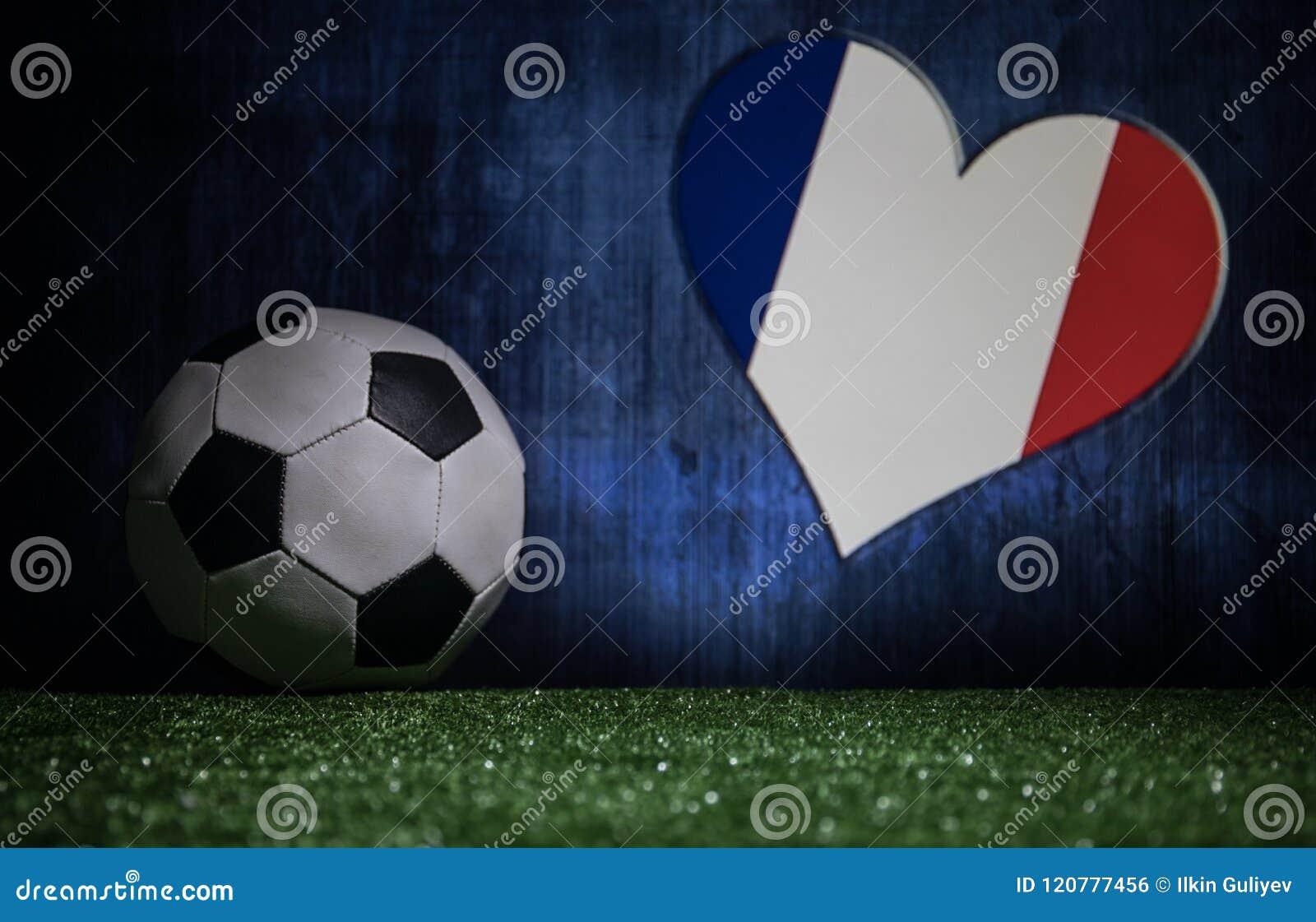 Soccer 2018. Creative concept. Soccer ball on green grass. Support France team concept.