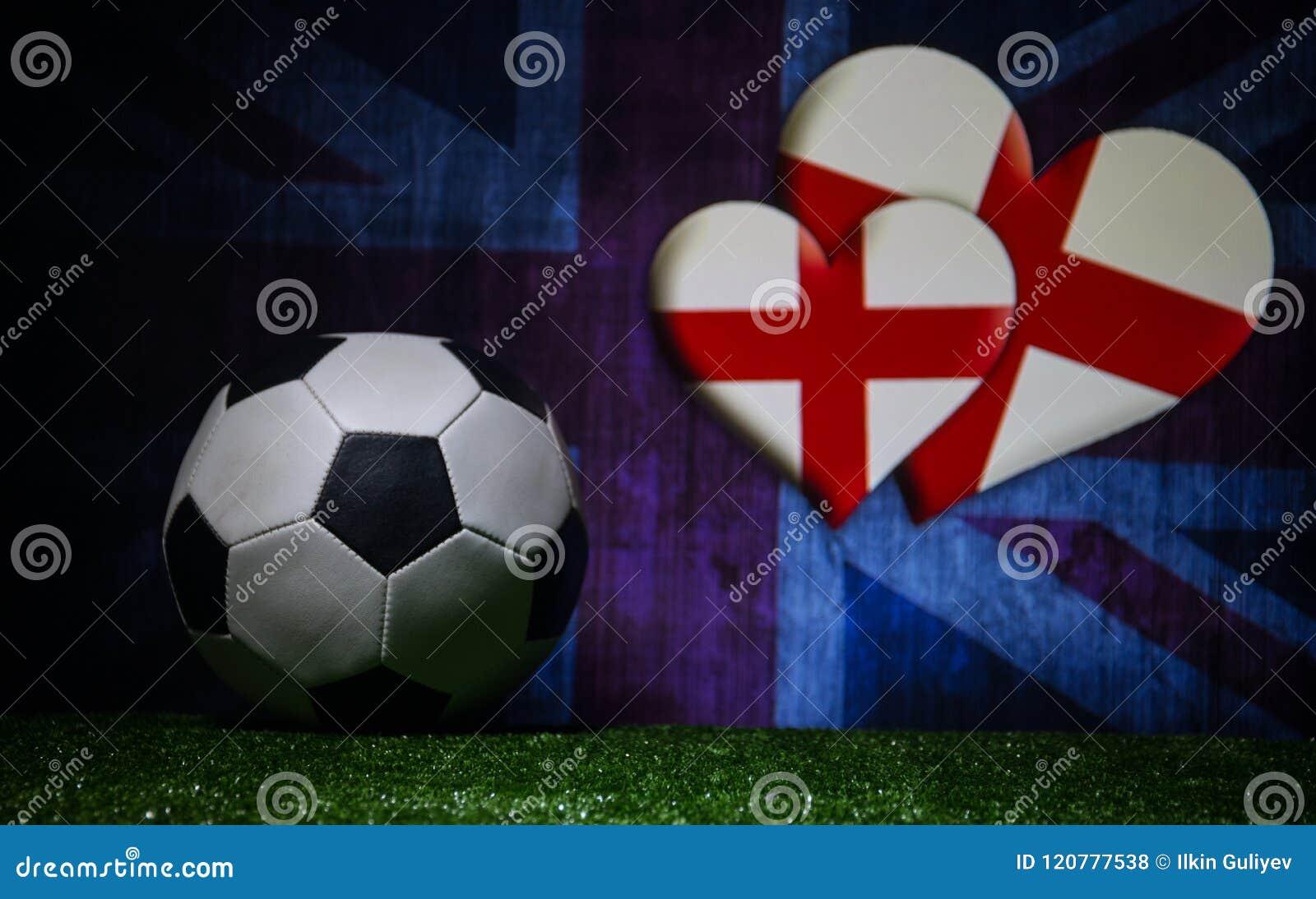 Soccer 2018. Creative concept. Soccer ball on green grass. Support England team concept