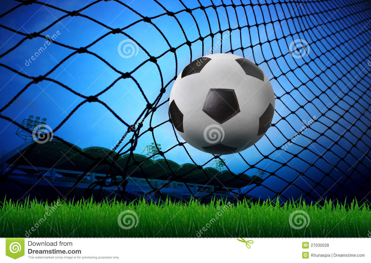 Soccer Football On Green Field With Blue Sky Background: Soccer Football In Goal Net And Stadium Blue Sky B Stock
