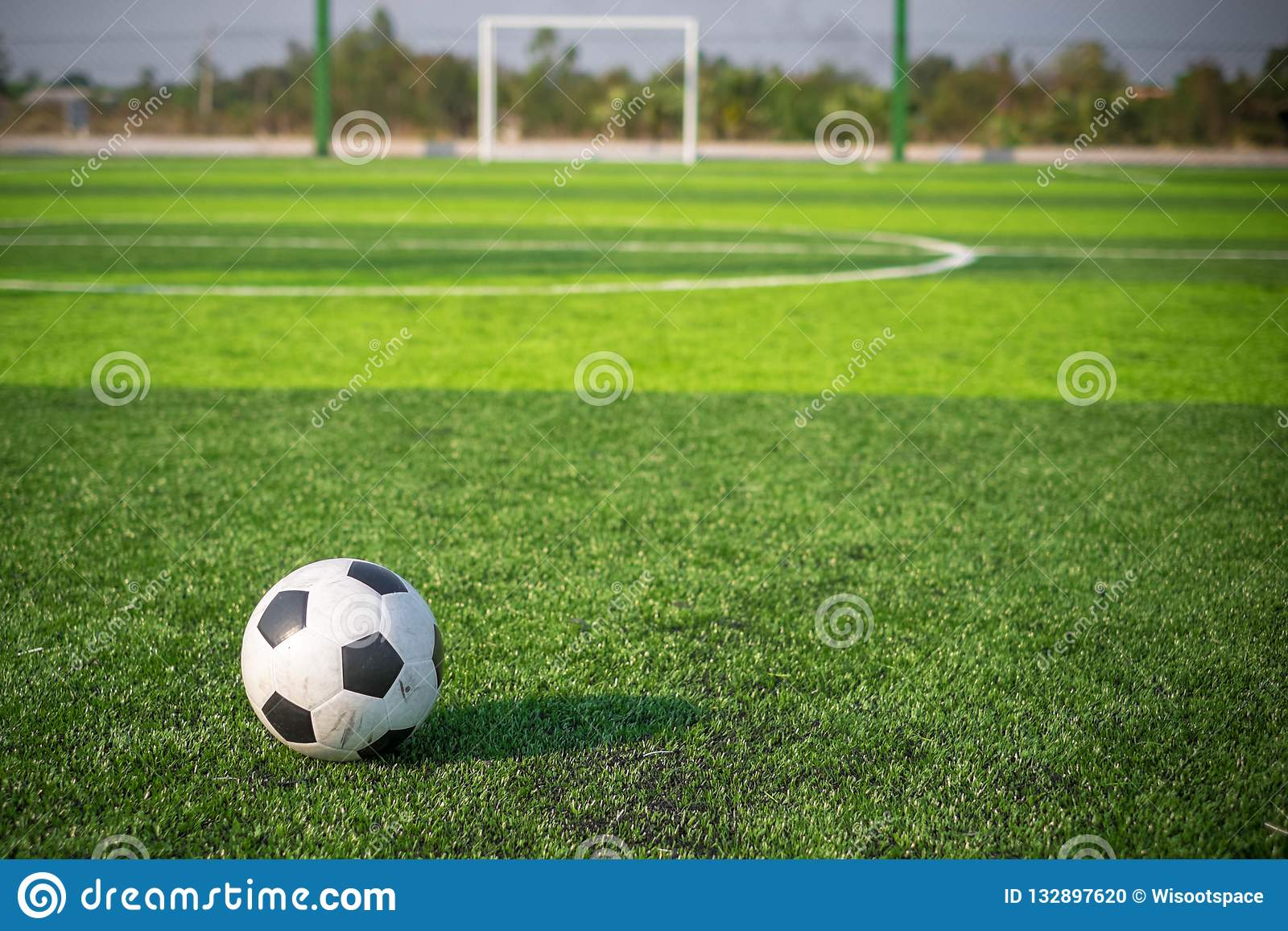 c1c40a147 Soccer football on green grass field and goal post Classic soccer ball on  artificial bright and dark green grass at public outdoor football or futsal  ...