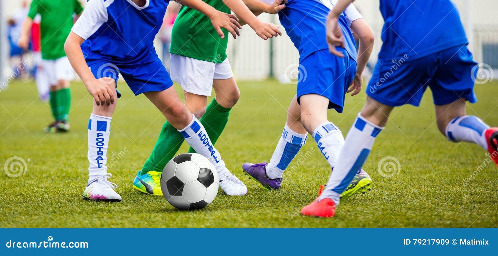 Soccer Game For Kids. Children Kicking Football Ball Stock