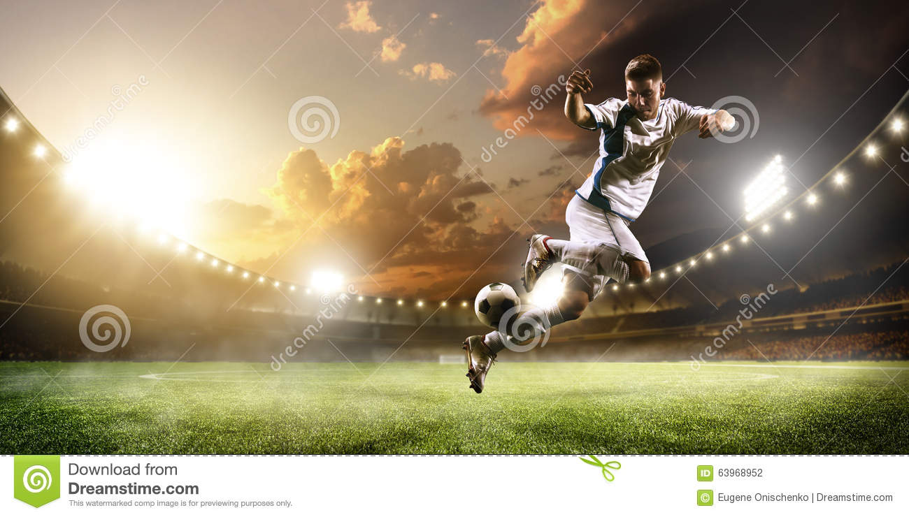 Soccer Player In Action On Sunset Stadium Panorama
