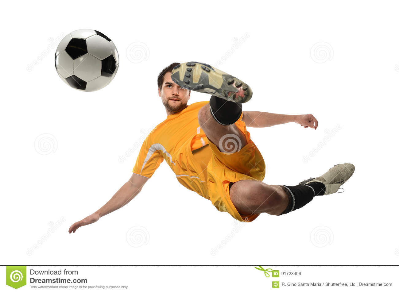 Soccer Player Kicking Ball in Midair