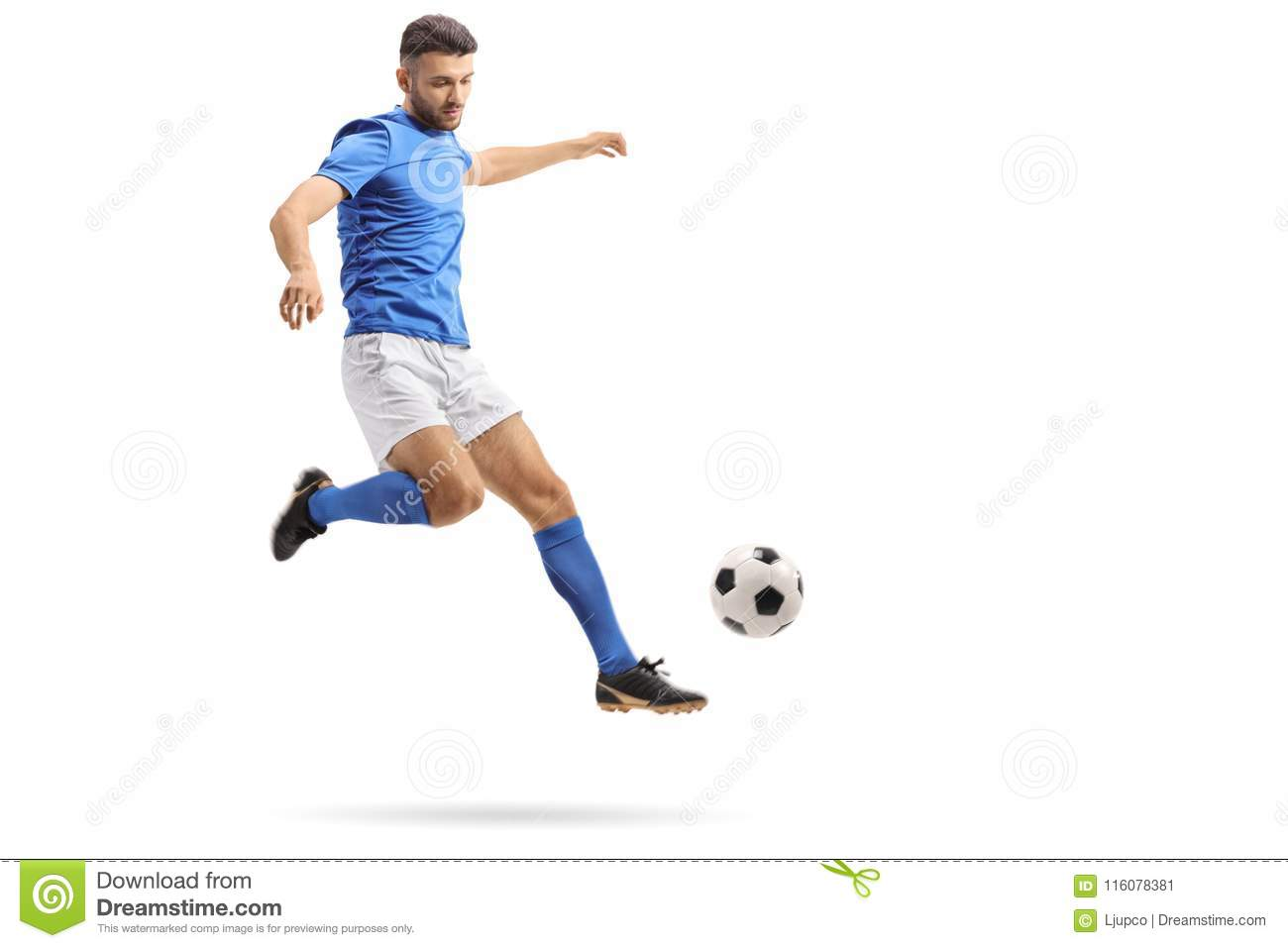 Soccer player in mid-air kicking a football