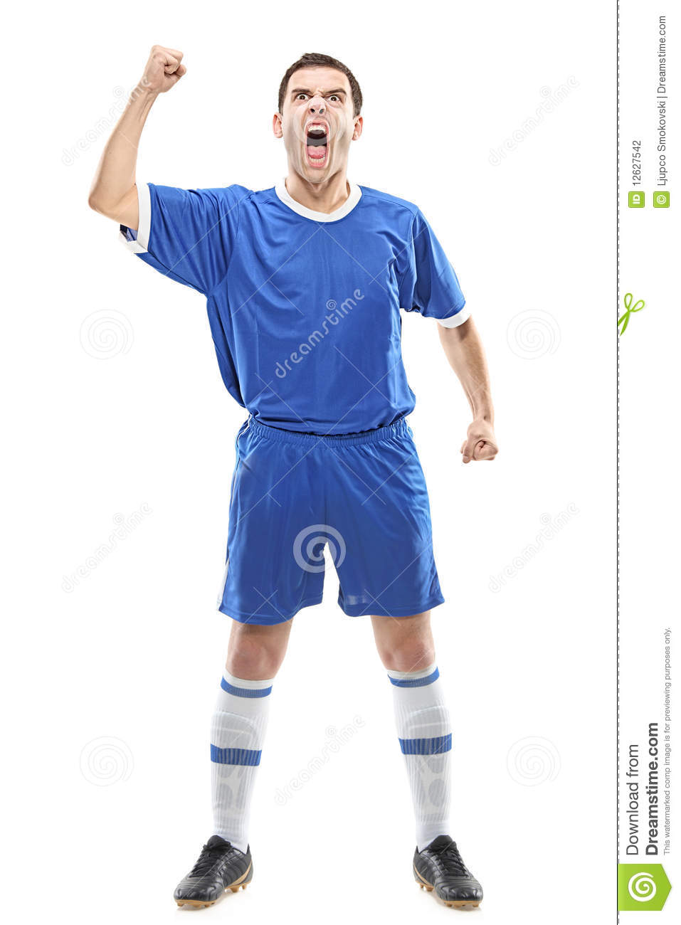 Soccer player standing and screaming isolated against white background ...