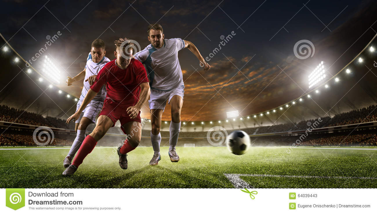 Soccer Players In Action On Sunset Stadium Background