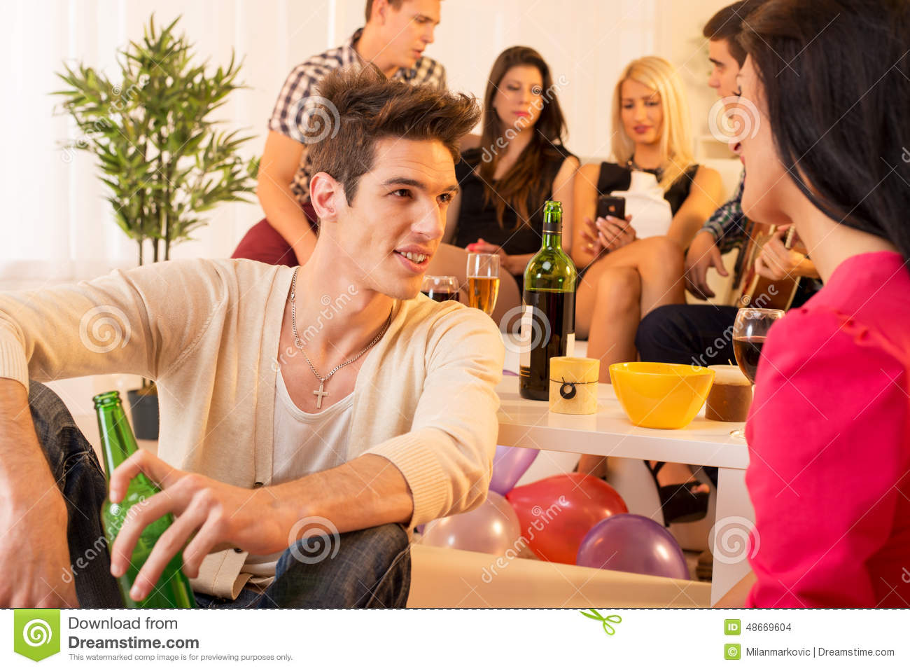 socializing at house party stock photo