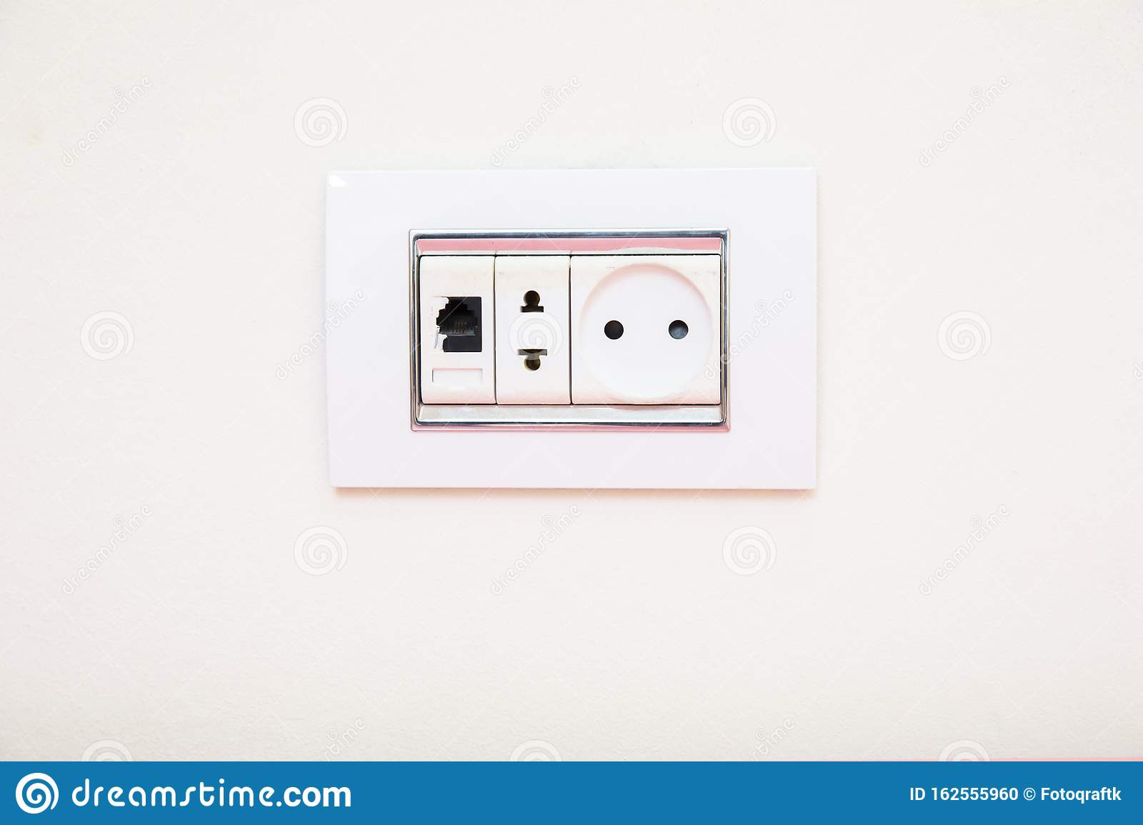 A Socket On A Light Gray Wall, A Multifunction Outlet With ...