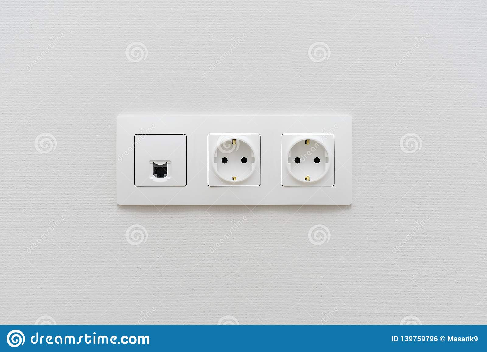 A Socket On A Light Wall, A Multifunction Outlet With An ...