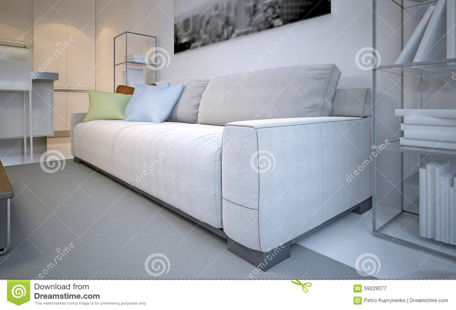 Sofá con las almohadas en el salón blanco