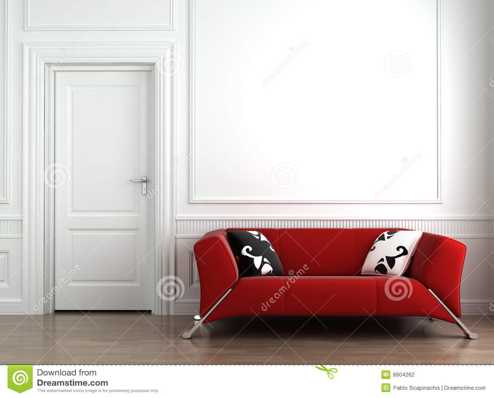 Sofá rojo en la pared interior blanca
