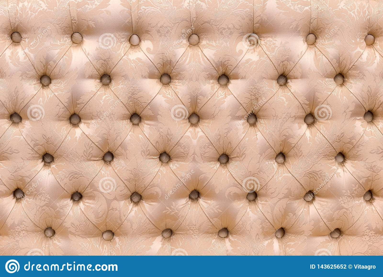 Sofa back upholstered in fabric as background and texture