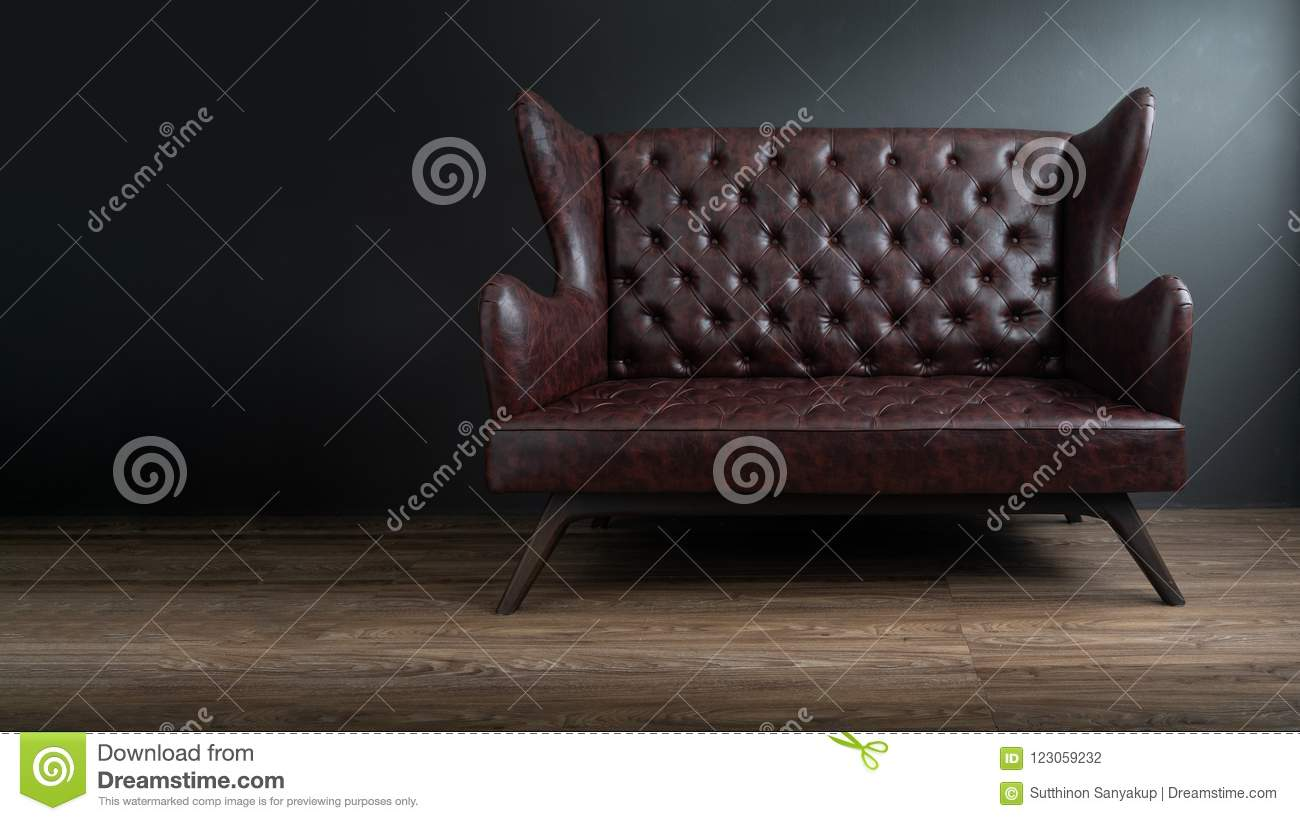 Sofa Of Black Leather Standing In Center On Concrete Floor