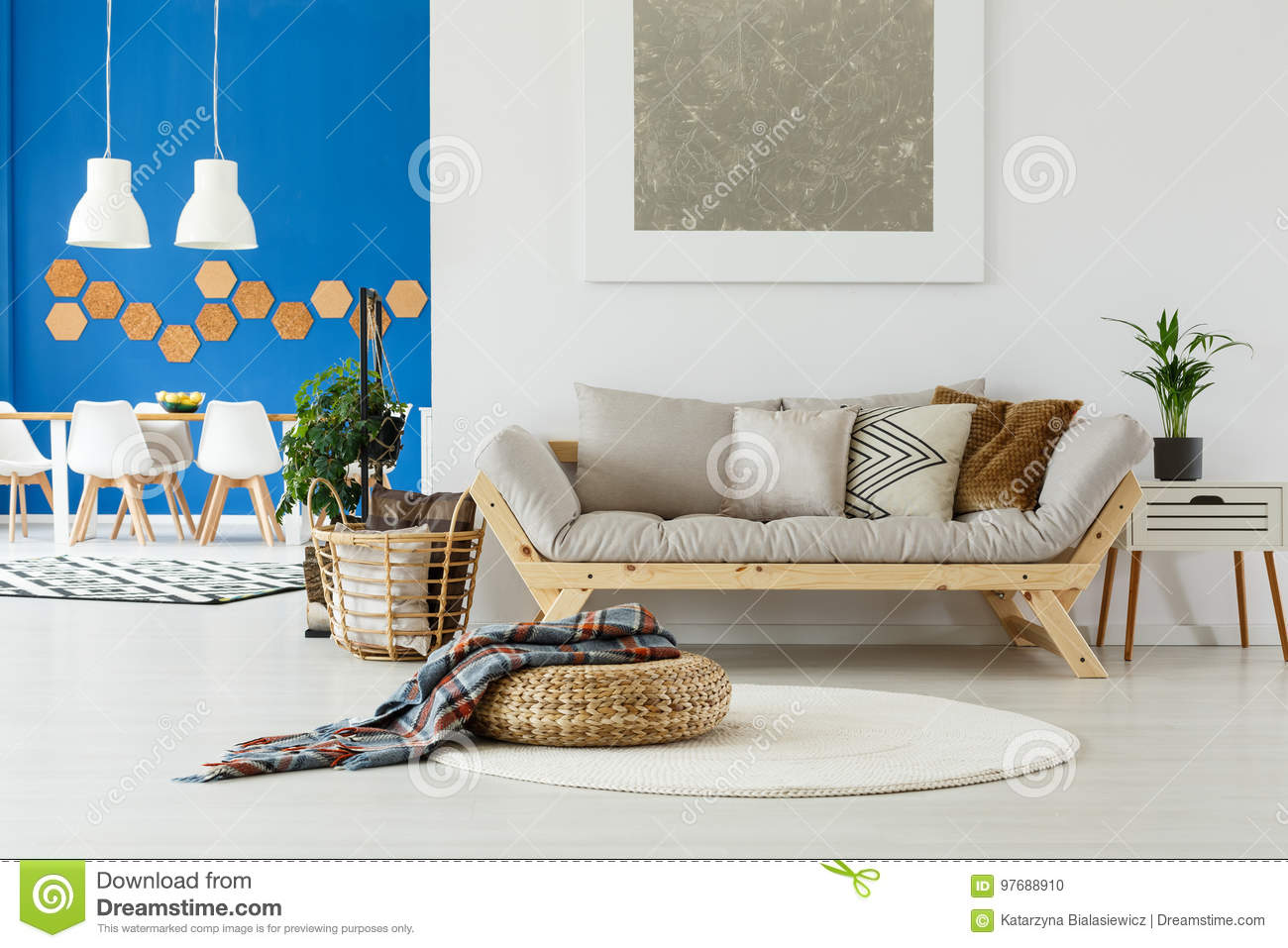 Sofa, plants and blue wall stock photo. Image of dining - 97688910
