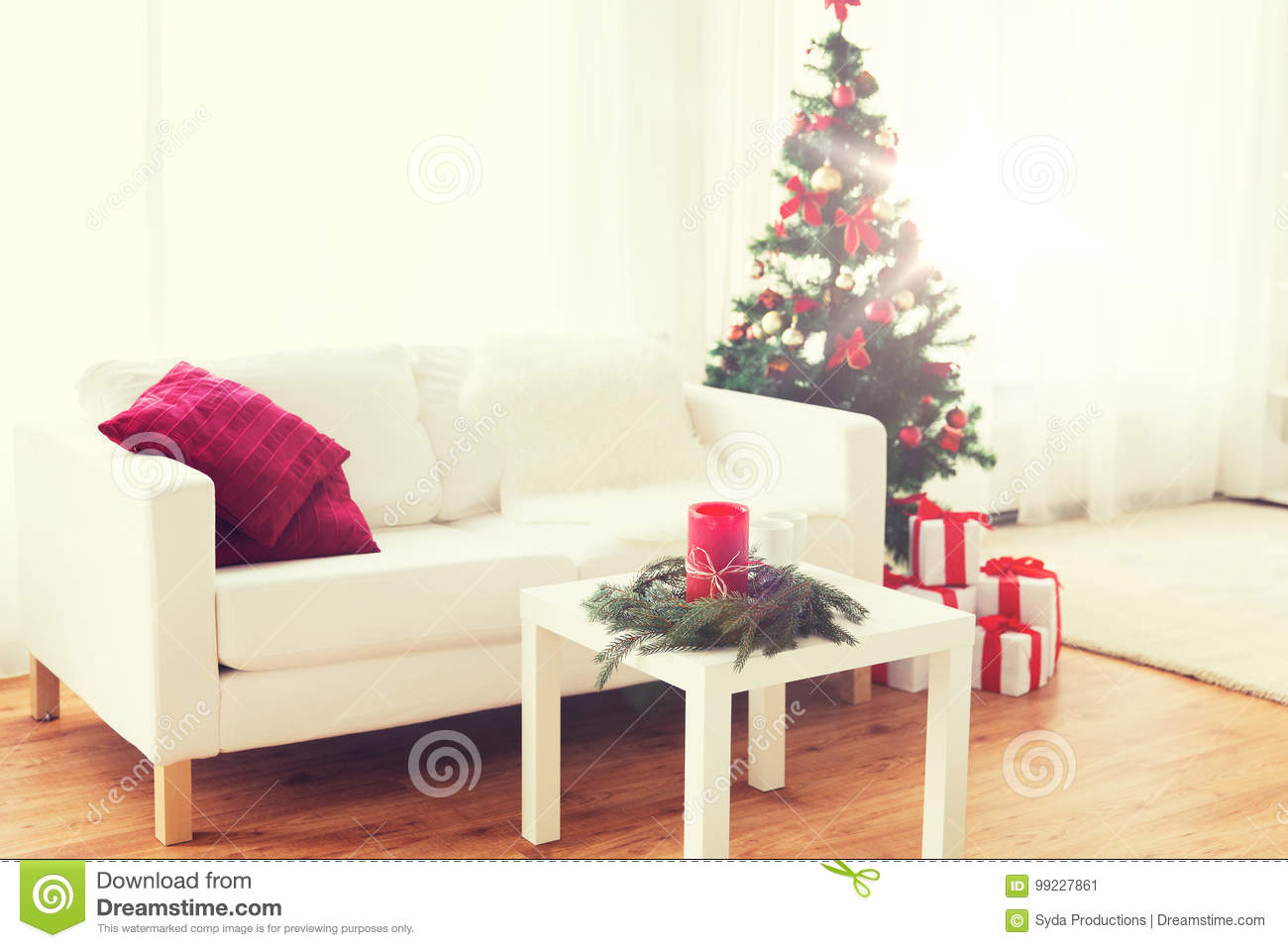 holidays celebration decoration and interior concept sofa table and christmas tree with gifts at home