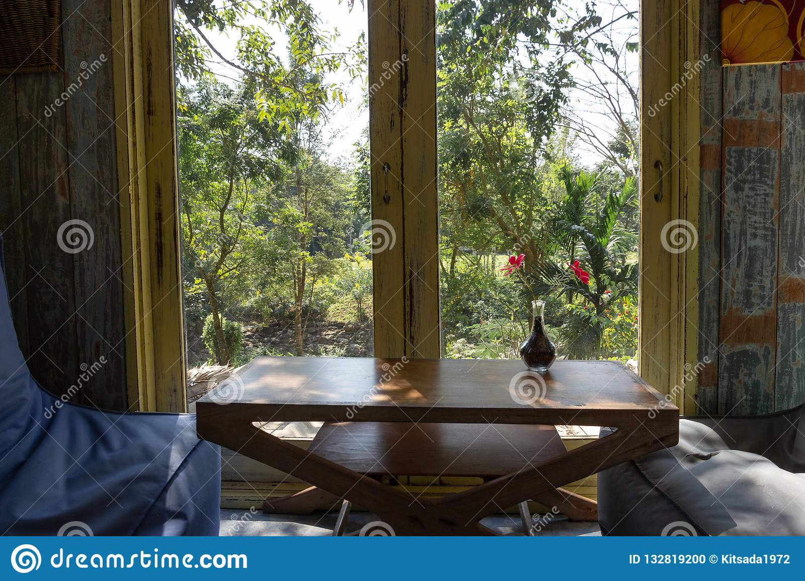 Awesome Sofa And Wood Table With Flower Decoration Beside The Garden Squirreltailoven Fun Painted Chair Ideas Images Squirreltailovenorg