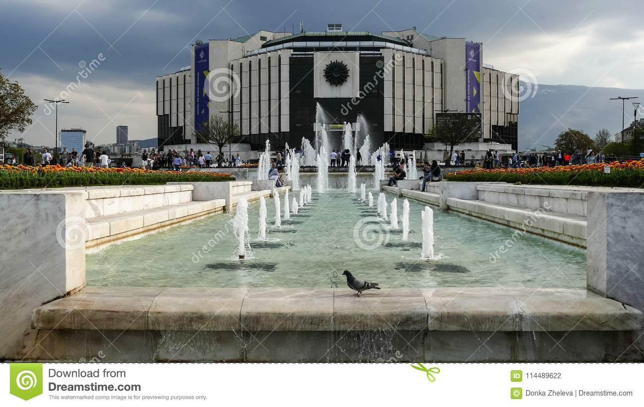 SOFIA, BULGARIA - APRIL 14, 2018: Fountains in front of the National Palace of Culture, Sofia, Bulgaria