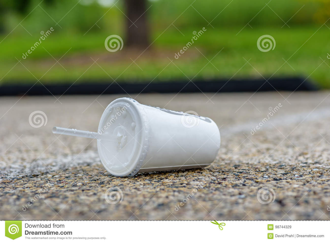 Soft drink cup litter on pavement