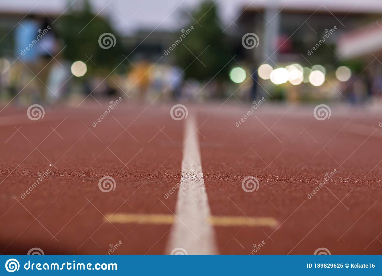 Soft Focus Red Running Track And Bokeh Background In Stadium