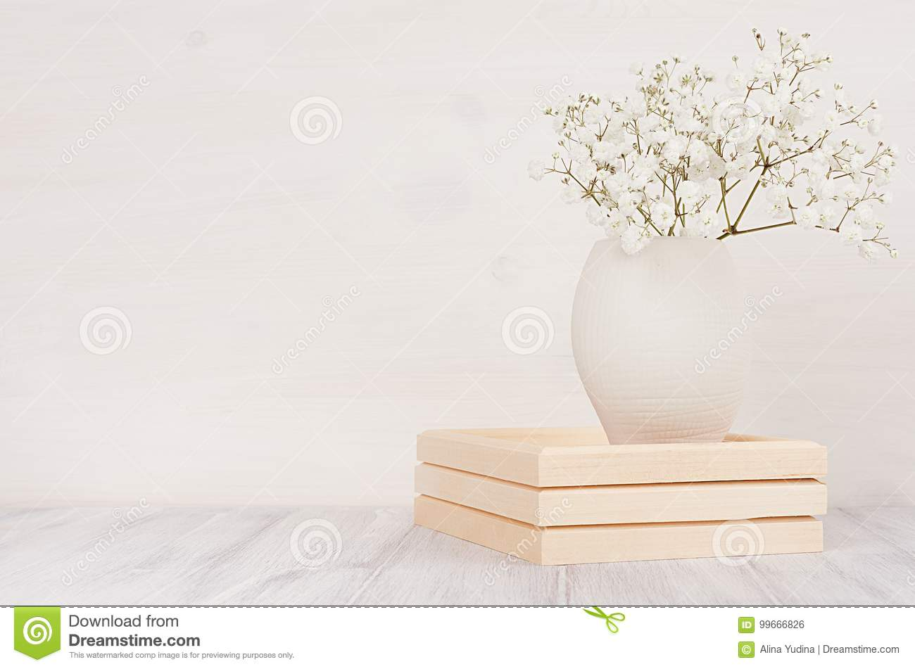 Soft Home Decor Of White Small Flowers In Ceramic Vase On White Wood