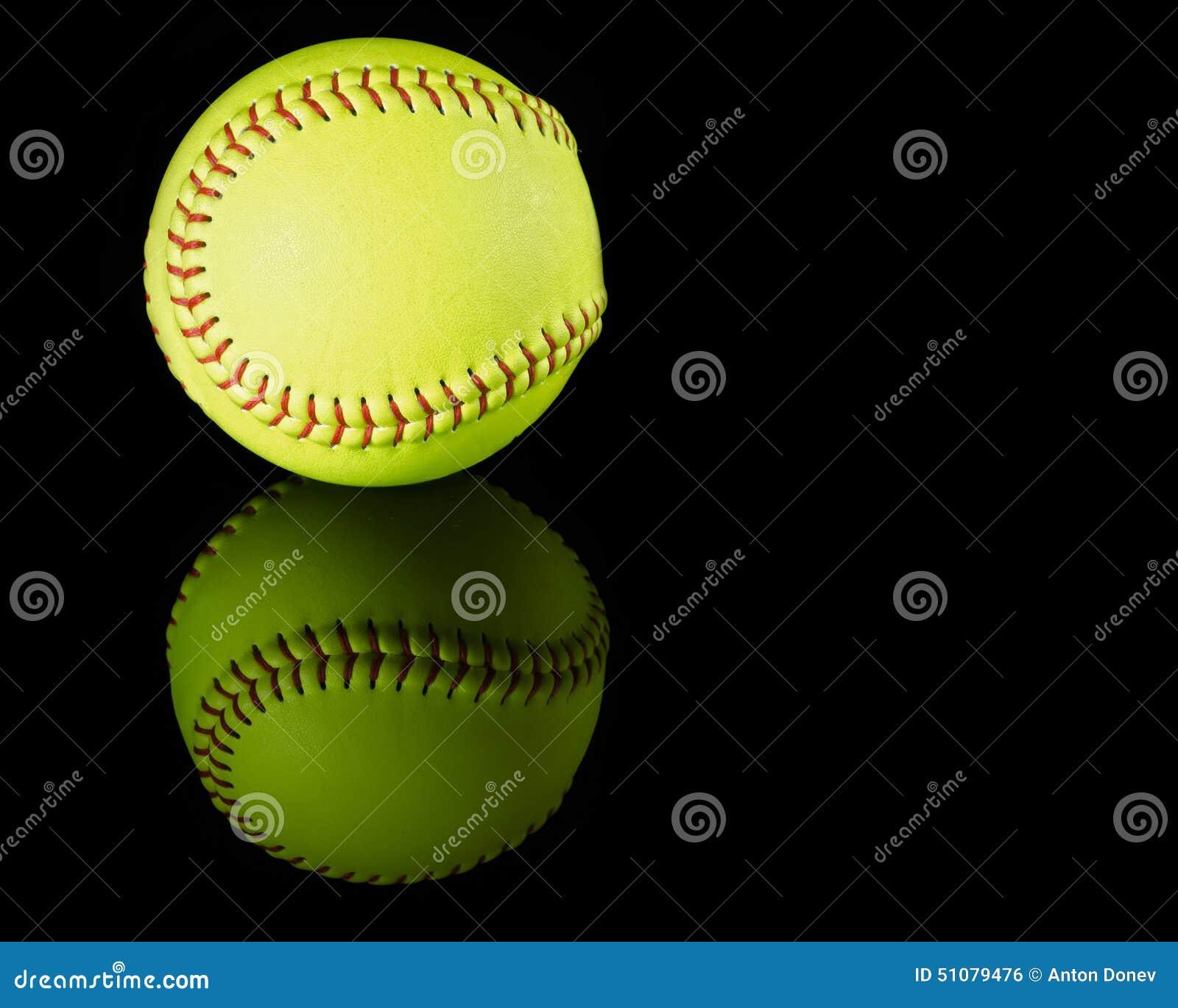 softball on black reflective background stock photo