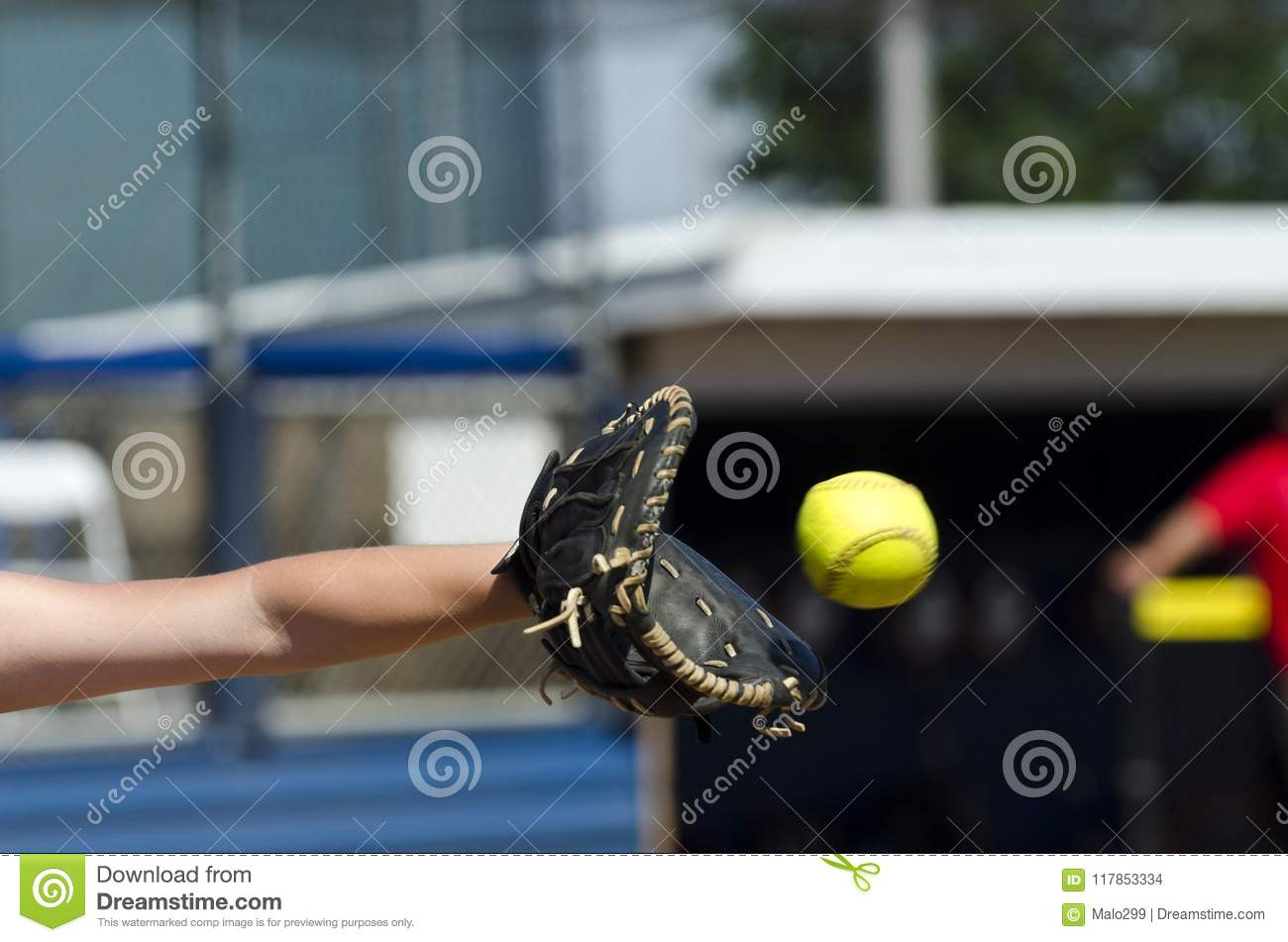Softball Player Reaches Out To Catch Ball