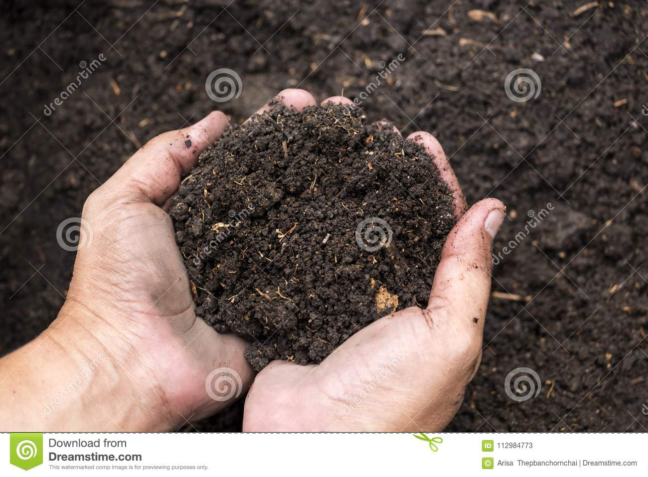 Soil in male hands`s farmer for agriculture, gardening or ecolog