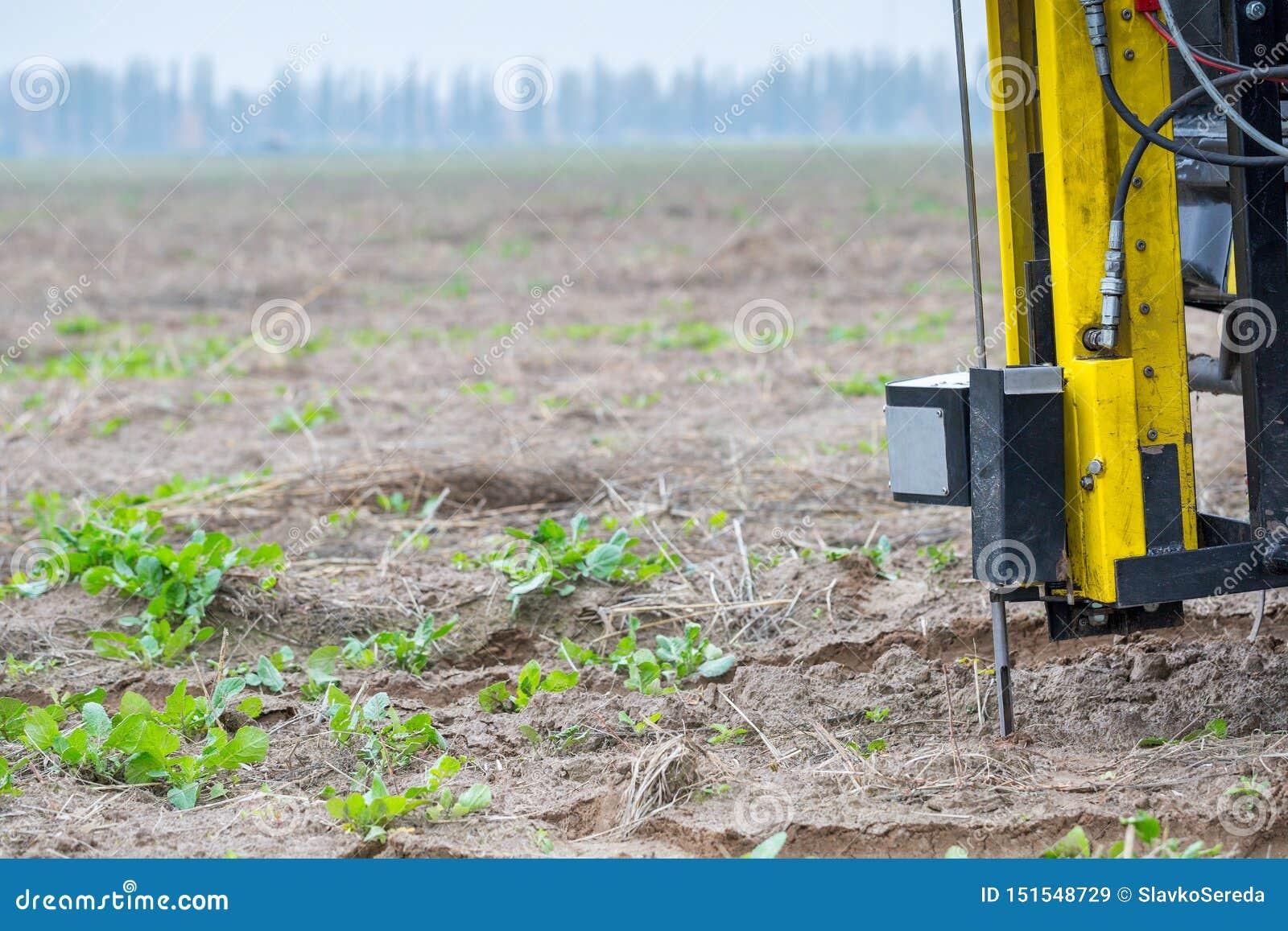 Soil Sampling. Automated probe for soil samples taking sample with soil probe sampler. Environmental protection, organic soil