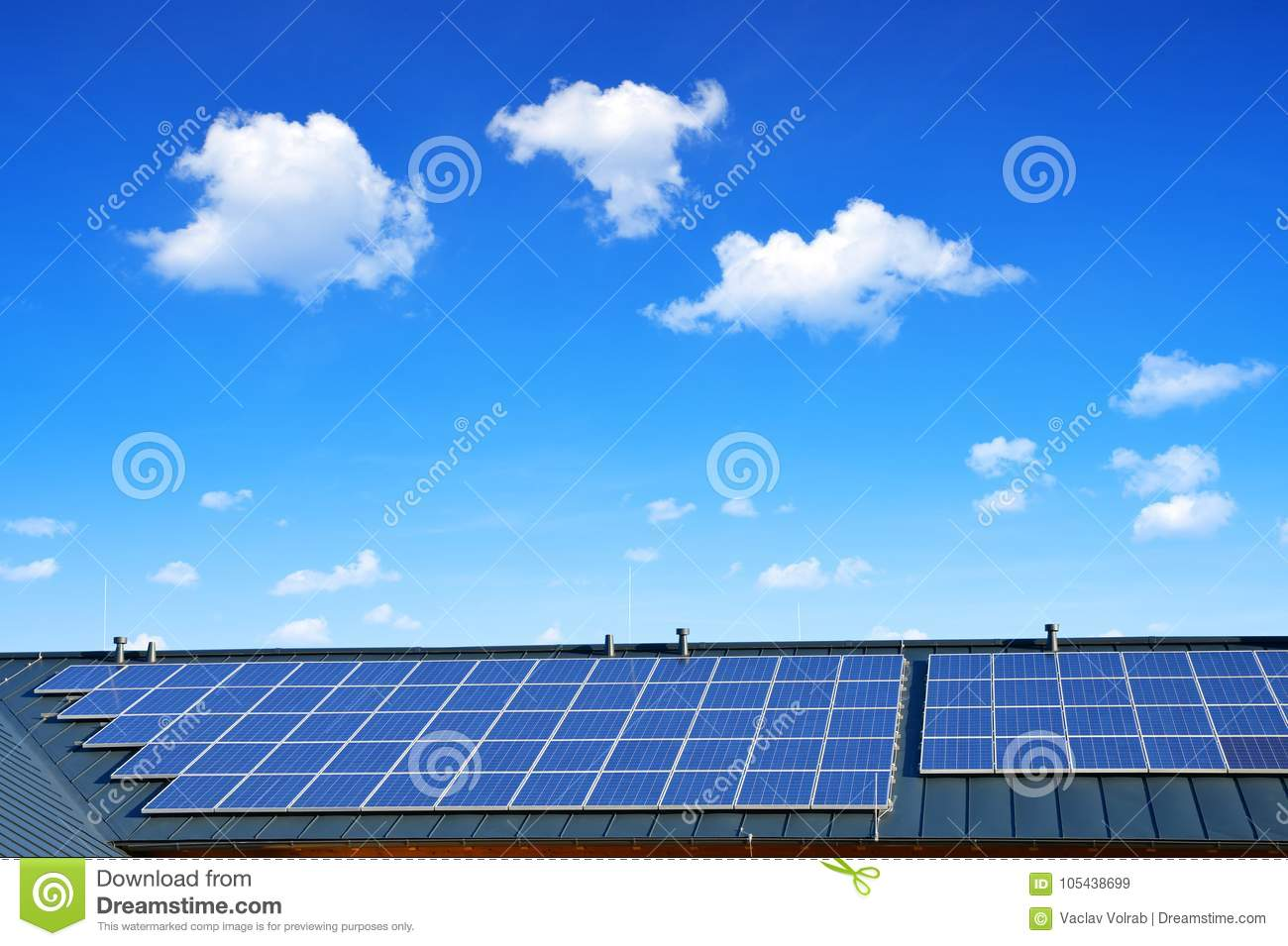 Solar energy panel on the roof of the house in the background blue sky.