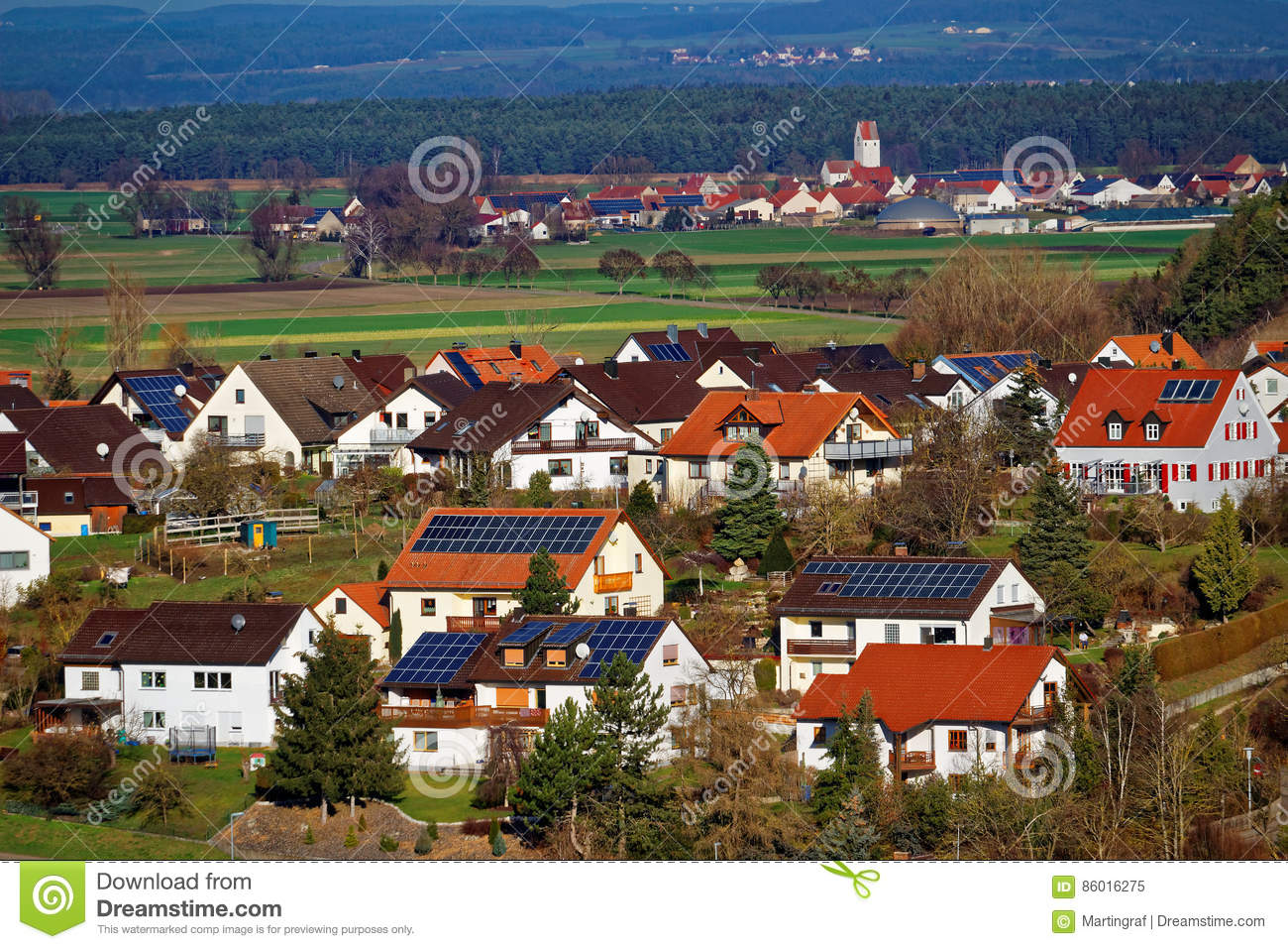 Solar energy panels on roofs of country village