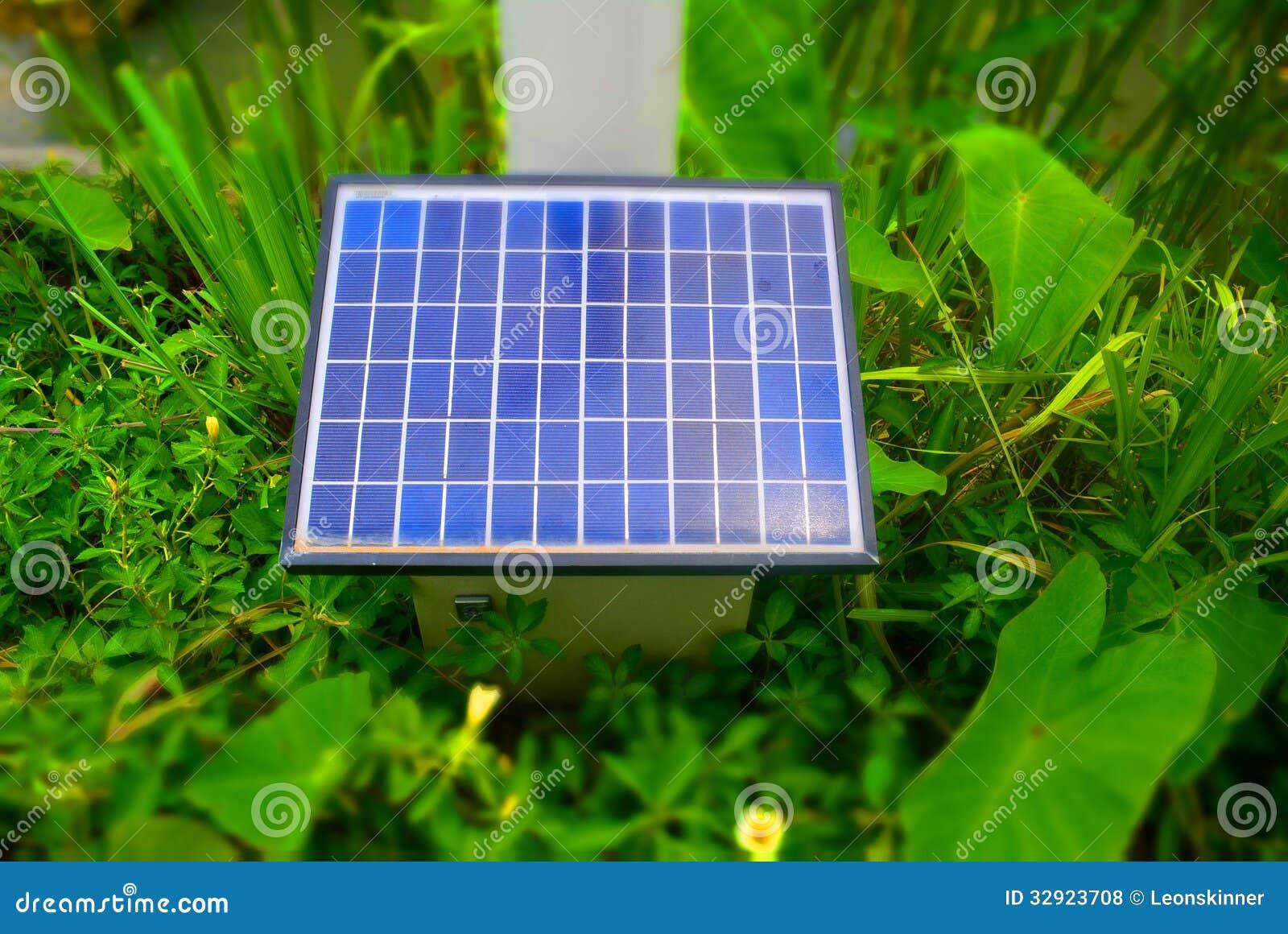 solar panel in green garden royalty free stock photos