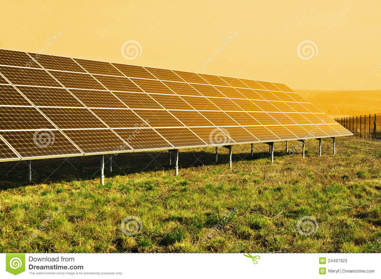 Solar panel generating renewable power from sun in yellow sunlight ...
