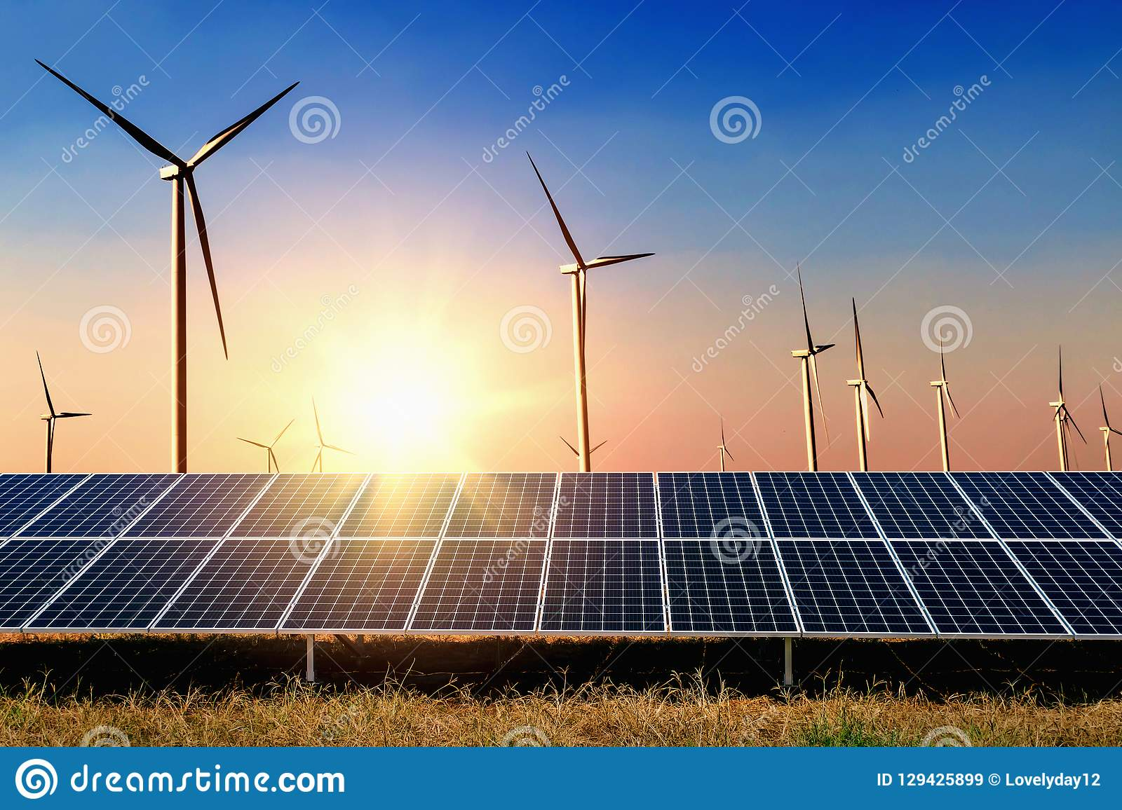 solar panel with turbine and sunset blue sky background. concept