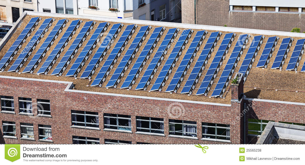 Building Solar Energy : Solar panels on building roof royalty free stock photos