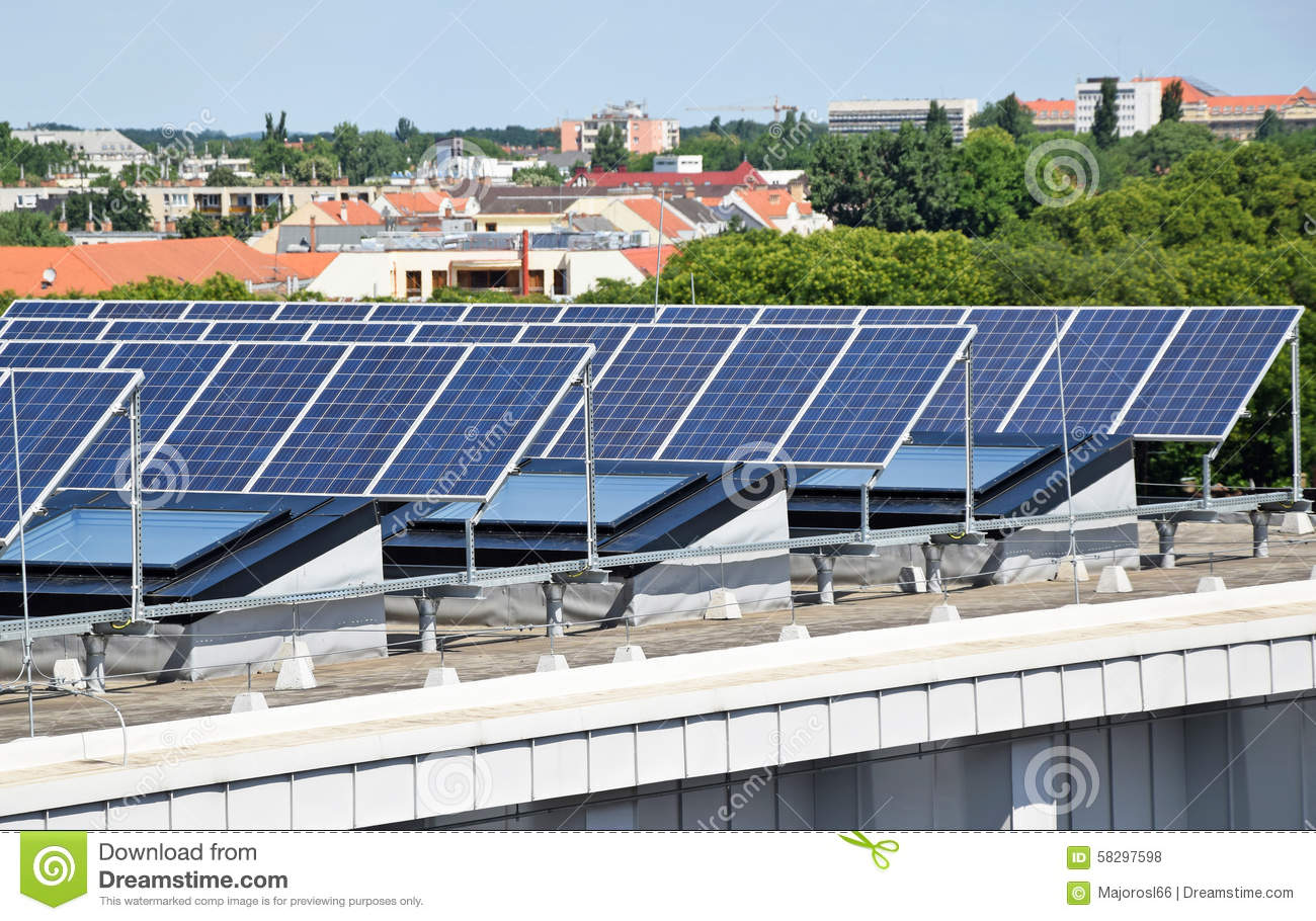 Solar Panel On Side Of Building : Solar panels on the top of a building stock photo image