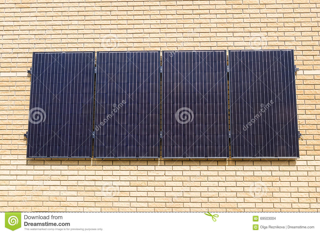 Solar Panel On Side Of Building : Solar panels on the wall of a building stock photo image