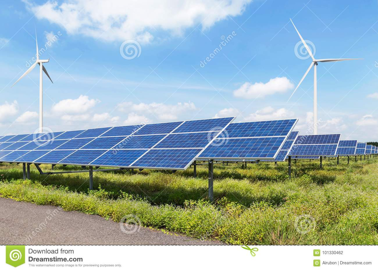 Solar panels and wind turbines in power station green energy renewable with blue sky background